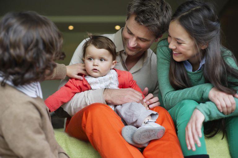 family gathered around baby