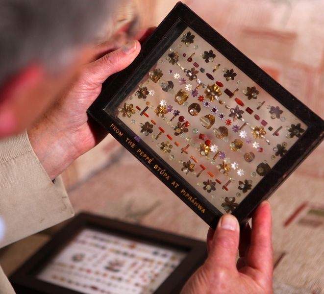 Author Charles Allen examines original jewels from Piprahwa Stupa