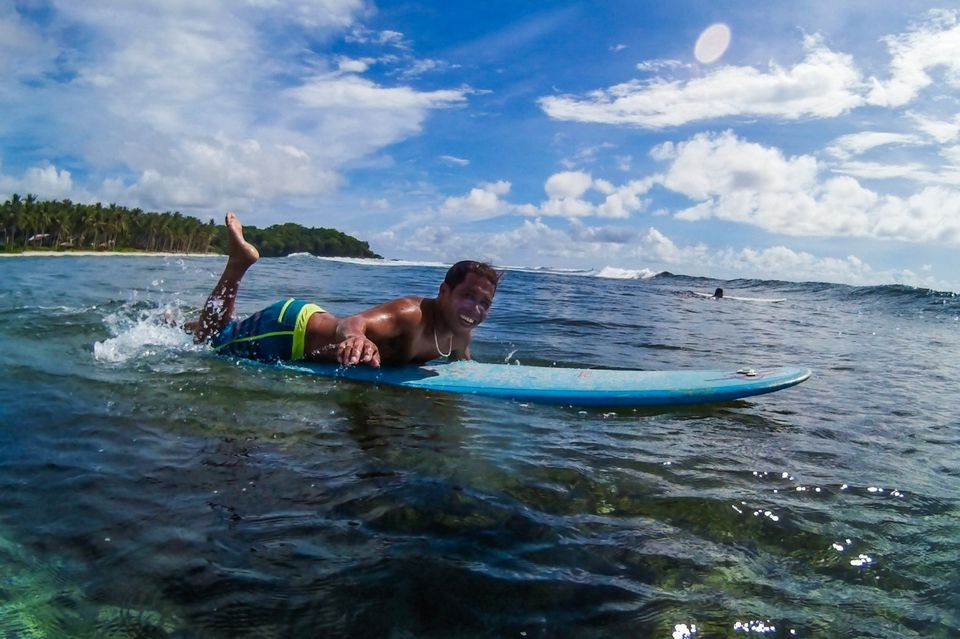 Surfer off Siargao Island, Philippines