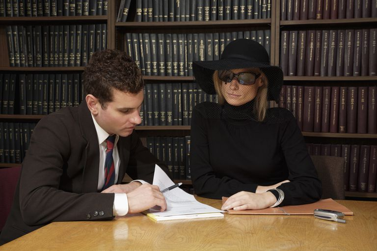 Lawyer reviewing will with widow