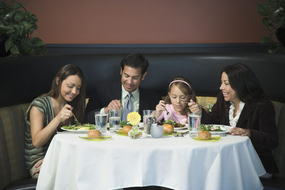 A picture of a family at a restaurant