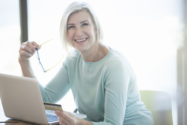 Smiling woman who found a career she enjoys.