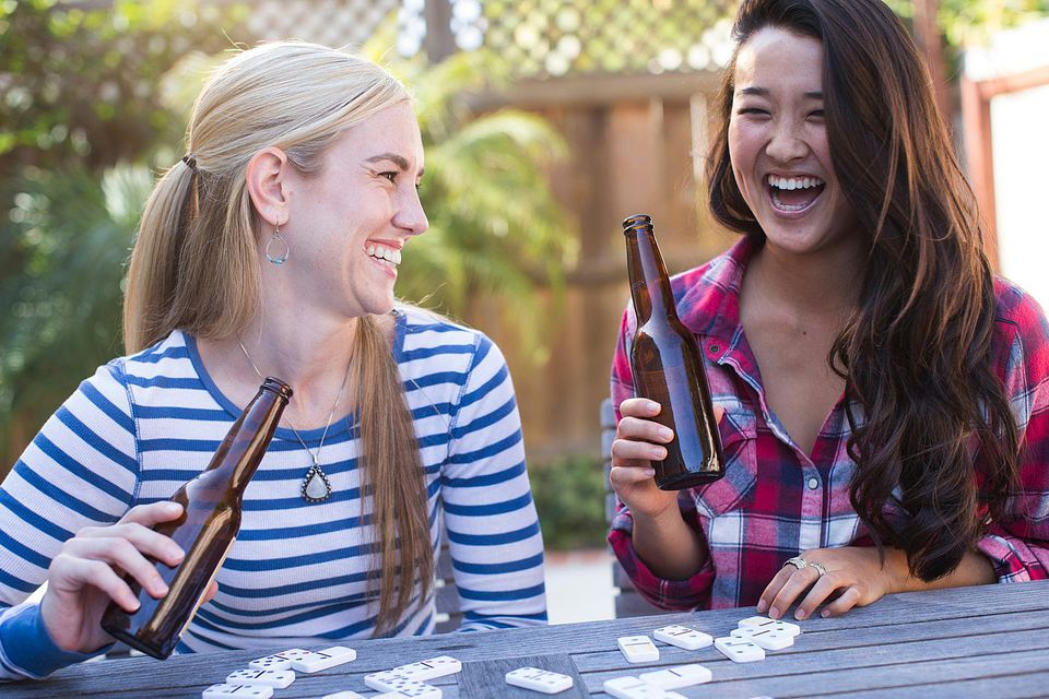 Two young women drinking beer