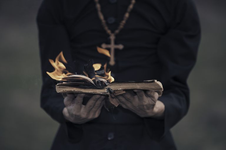 Exorcist with burning bible