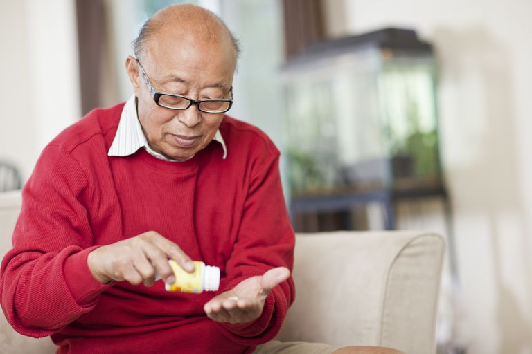 Chinese man taking medication