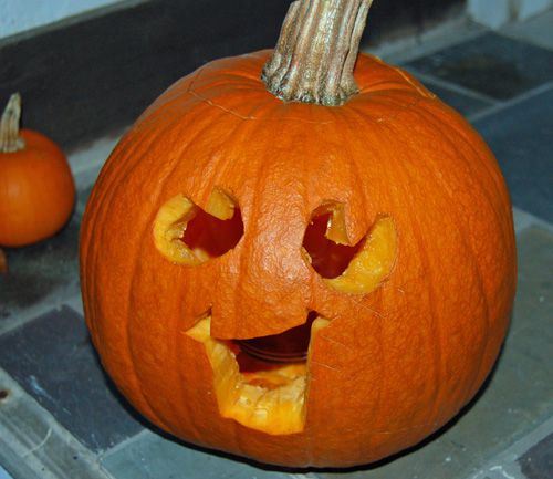 Happy Pumpkin Face - Photo of Happy Carved Pumpkin Face