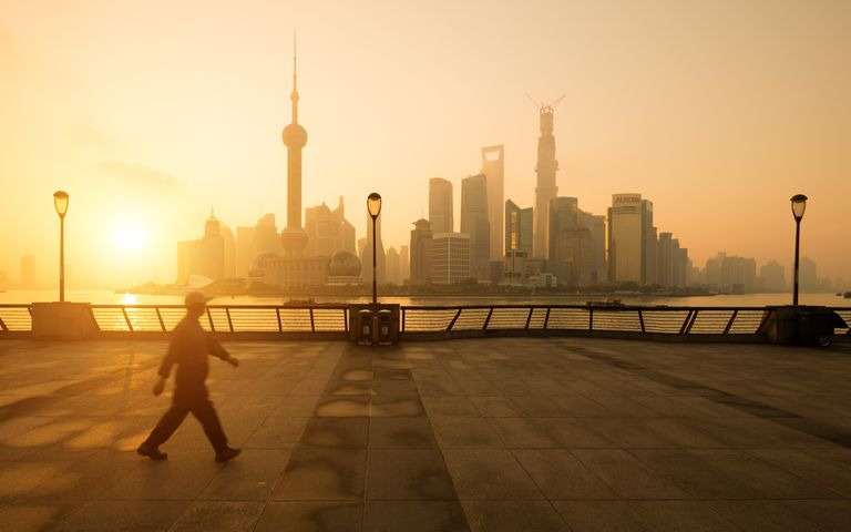 Sunrise on Bund Shanghai with walking man