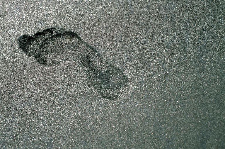 Footprint in black sand