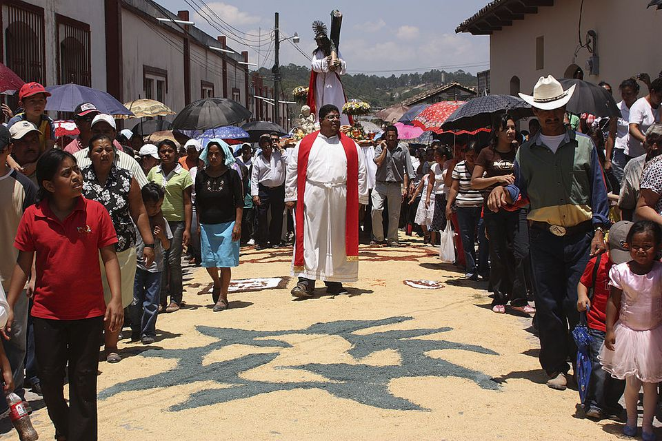 Holy Cross Procession on April 10, 2009 in Santa Rosa de Copan, Honduras. The small mountain town of Santa Rosa de Copan is well known for its traditional Semana Santa celebrations. Spanning a total of four days, a number of religious processions re-enact the events leading up to the crucifixion and resurrection of Christ. On Friday morning the streets of the town are decorated with an impressive array of coloured carpets consisting of sawdust, flowers and seeds. The Holy Cross Procession, which takes place shortly afterwards, is regarded as the most spectacular procession of the week.