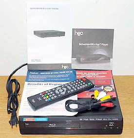 Haier HEC BDP100 Blu-ray Disc Player - Front View with Included Accessories