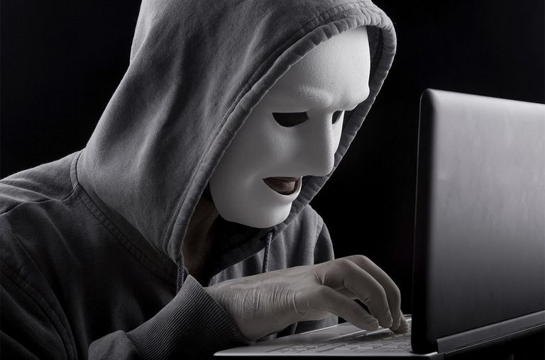 Computer Hacker with mask