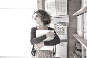 Businesswoman holding folder in office