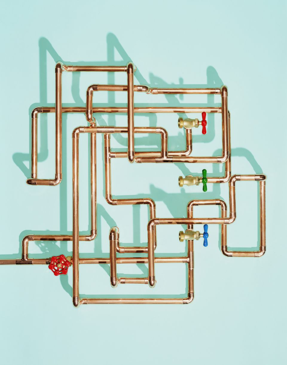 tangle of pipes, valves and drains