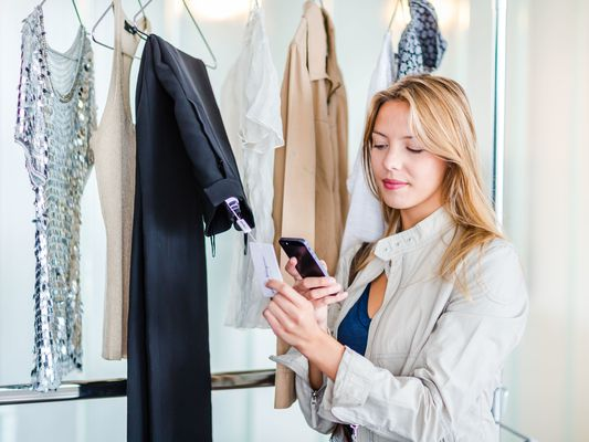 Woman using a selling app to sell her clothes