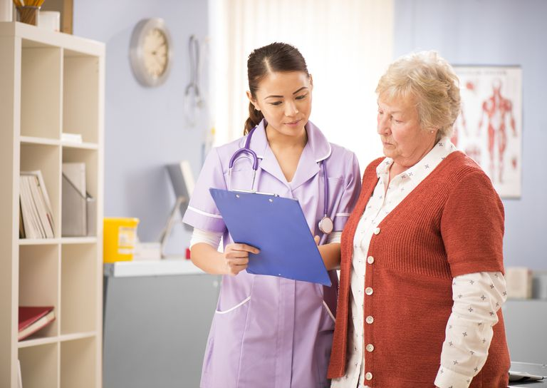 nurse chats to senior patient