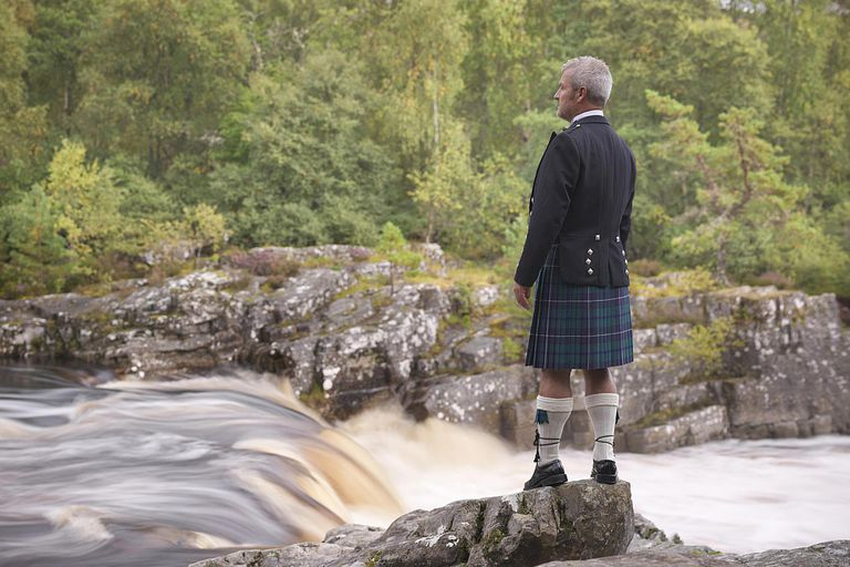 Time lapse view of man in kilt by river