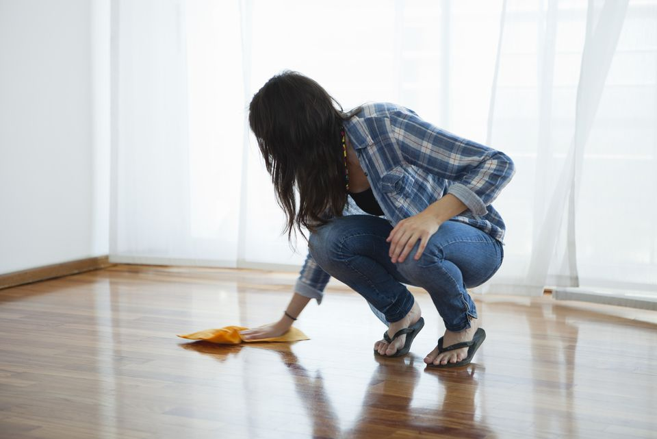 Woman wiping hardwood floor