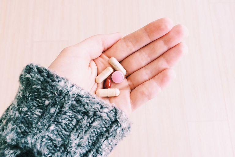 Pills in girls hand