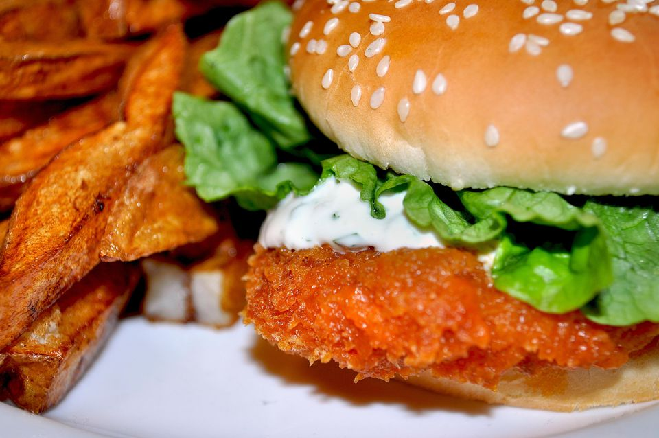 A chicken cutlet sandwich with fries