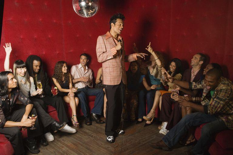 Man doing Karaoke with friends