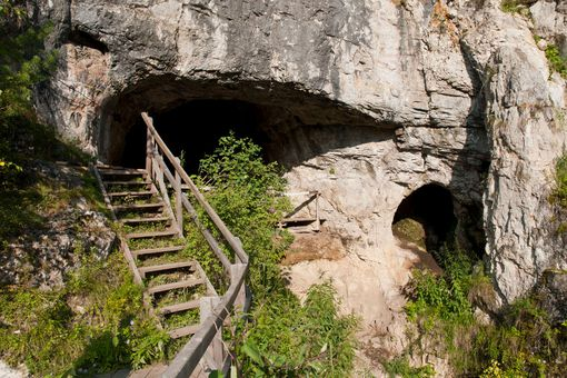 Entrance to the Denisova cave in southern Siberia, Russia.