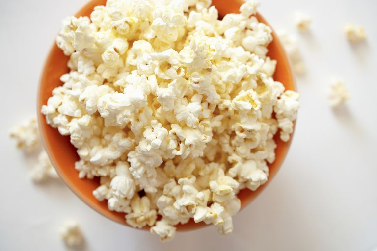 Popcorn has a hard outer shell that allows pressure to build up inside each kernel until it pops.