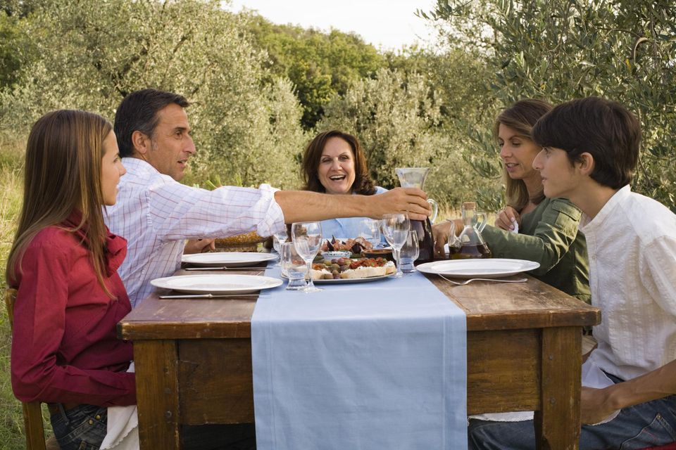 Tuscan family at outdoor dinner , Montevettolini , Italy.