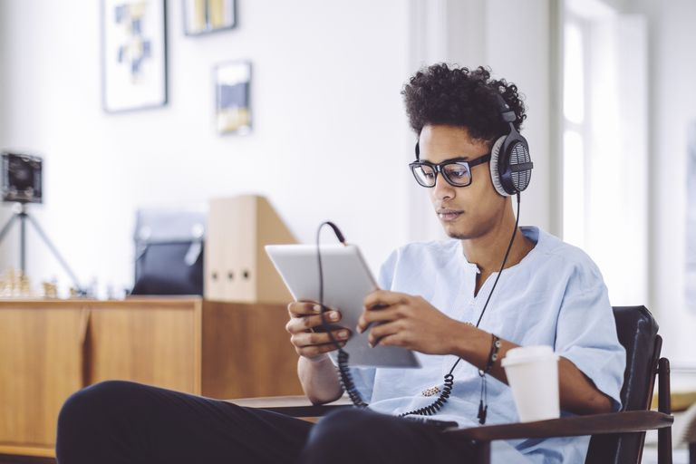 Young man is listening music at home