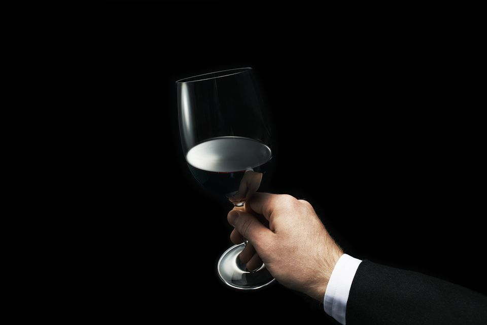 Man Holding A Glass of Red Wine