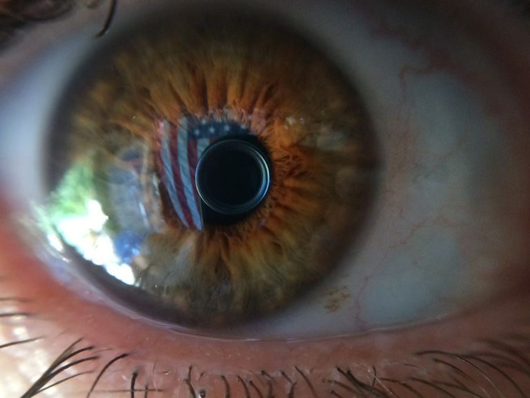 Close-Up Of American Flag Reflected In Eyeball