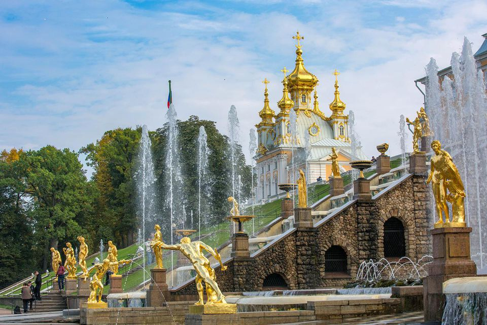 Peter the Great's summer palace in late autumn afternoon, golden light, fountain open.