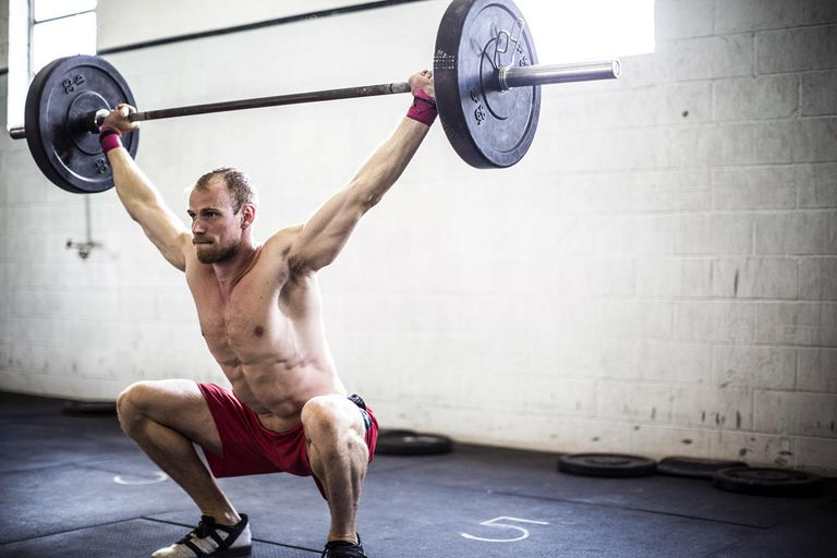 man doing cross fit snatch