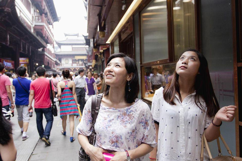 Young women walking Yuyuan Tourist Mart