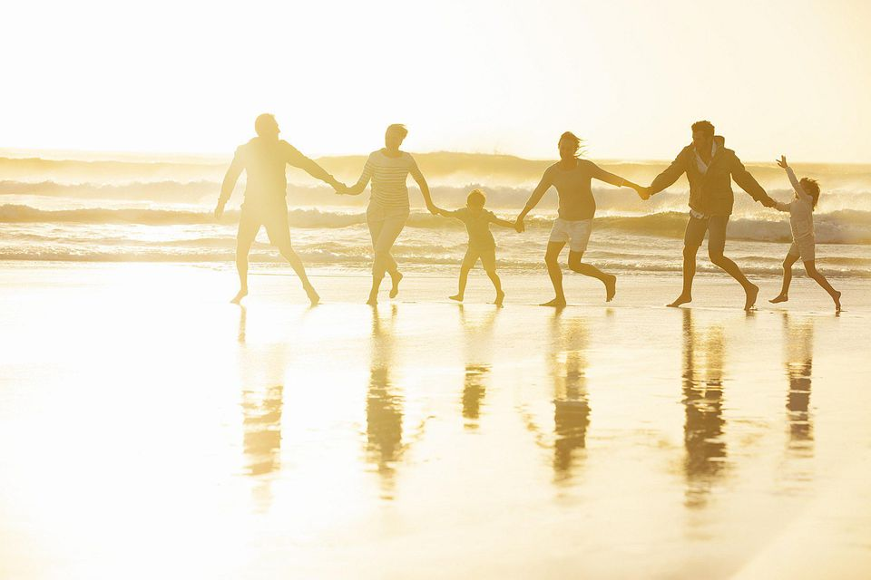 A picture of a big family on the beach
