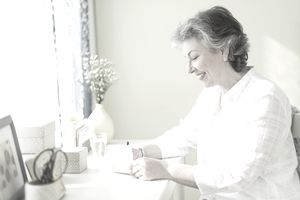 Mature woman writing letter