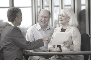 Senior couple happy to find out they are the right to make an IRA contribution.