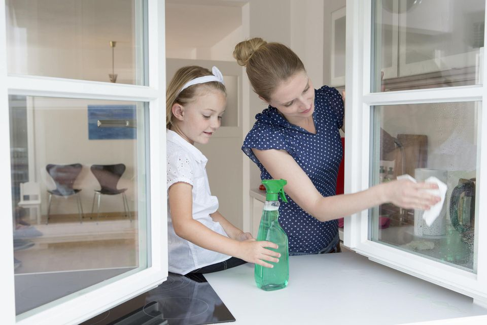 A picture of a mother and daughter cleaning together