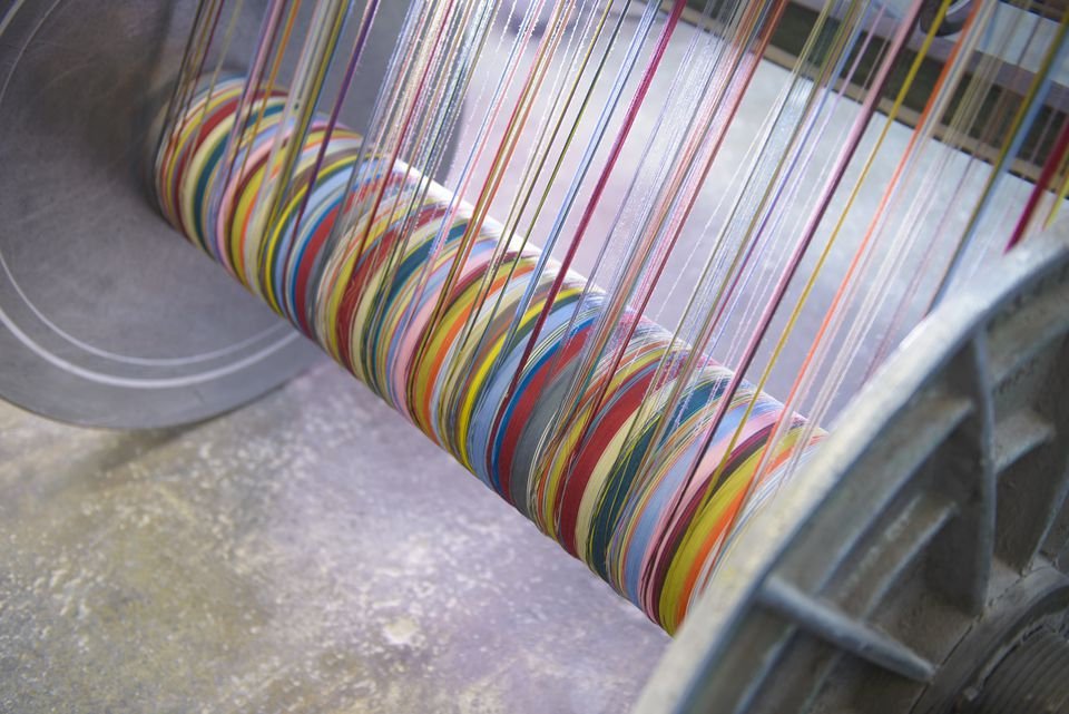 Weaving loom with colorful strands of dyed fiber