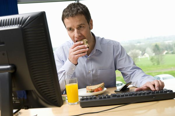 Man eating lunch at work