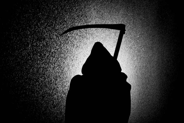 Death in the form of The Grim Reaper