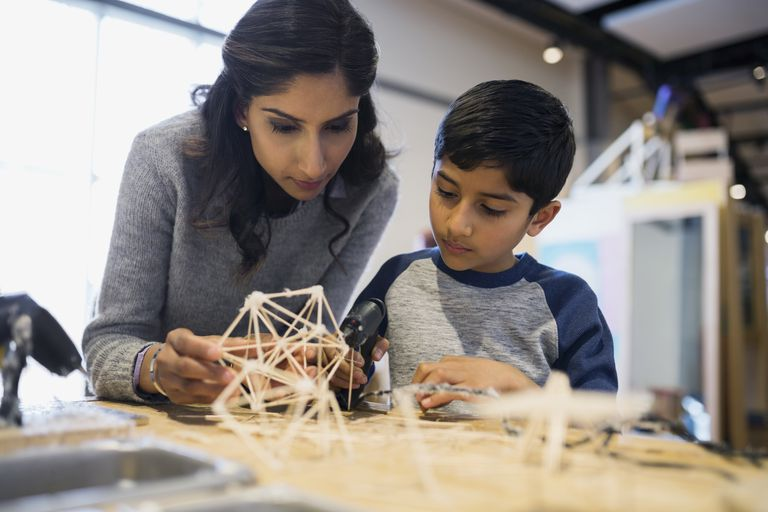 Mother and son assembling toothpick model science center
