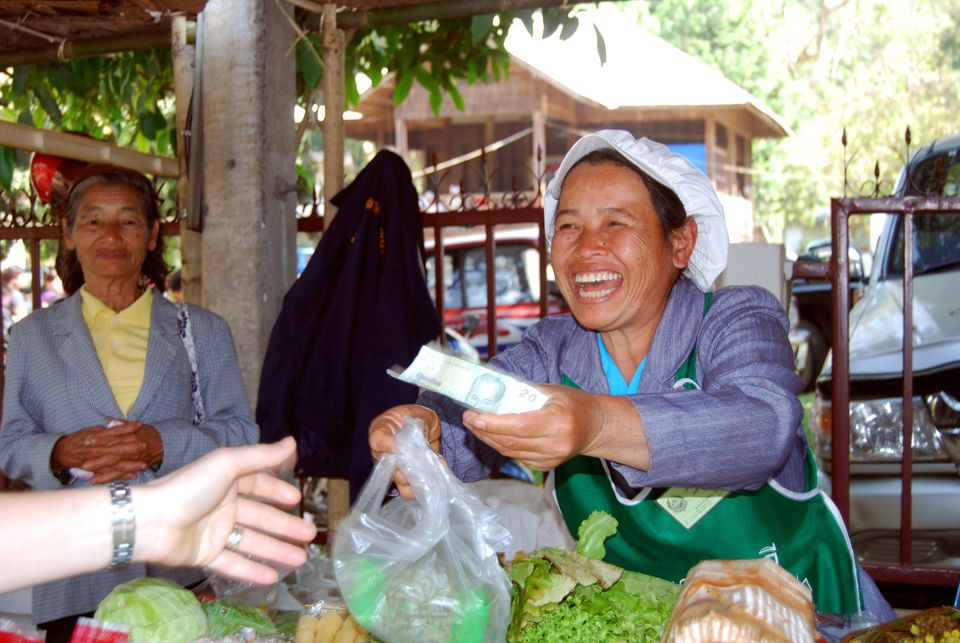 Thailand street cart handing money