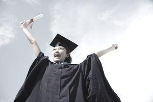 University student in graduation robe cheering