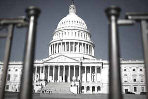 US Capitol Building seen through fence