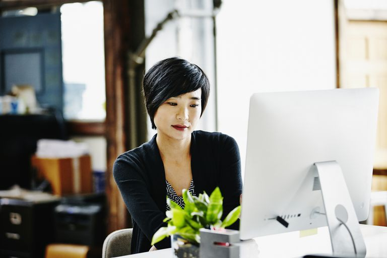 Businesswoman at desk on computer