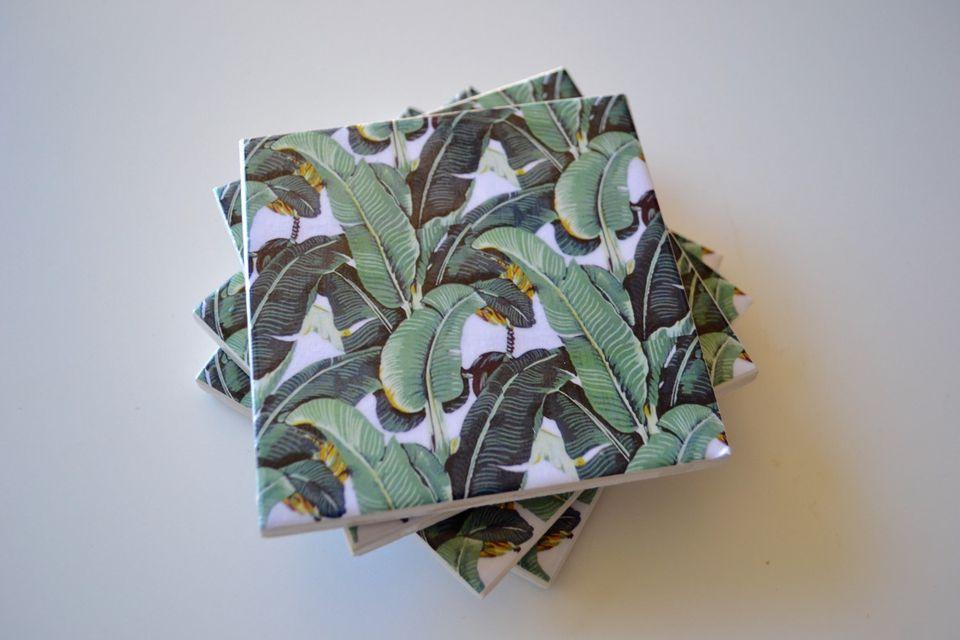 Ceramic tile coasters with banana leaf print