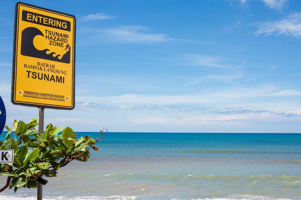 Tsunami warning sign on Batu Balong beach, Bali, Indonesia