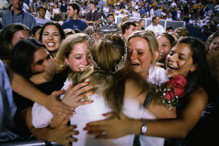 Young Women Hugging Homecoming Queen