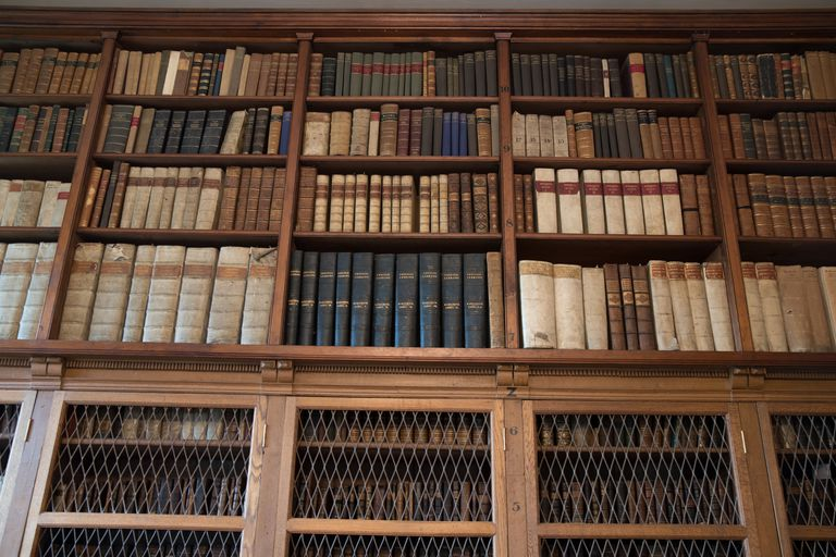 Books on the shelves of the Ancient Library at Salisbury Cathedral in England