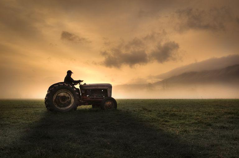 Farmer riding tractor